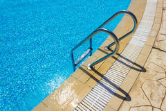 Grab bars ladder in the swimming pool Royalty Free Stock Photos