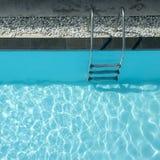 Grab bars ladder in swimming pool Royalty Free Stock Photos