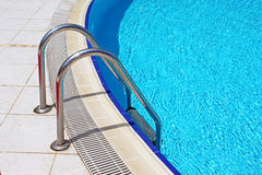 Grab bars ladder in the swimming pool Royalty Free Stock Photography