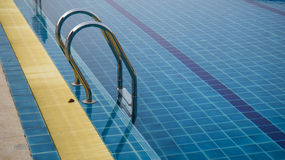 Grab bars ladder in the swimming pool Stock Photo