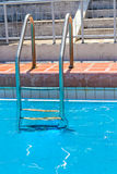 Grab bars ladder in swimming pool Royalty Free Stock Images