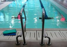 Grab bars ladder in the swimming pool Stock Images