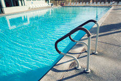 Grab bars ladder in the swimming pool Stock Image