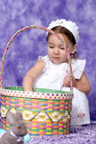 Grab an egg. Baby and her Easter Basket Stock Photo