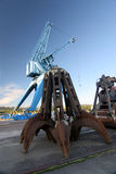 Grab infront of a harbor crane. Grab infront of a port crane in Linz, Austria. Huge crane used to clear ships to boxcars at the Danube river Royalty Free Stock Photo