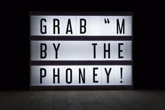Grab m by the phoney Stock Photos