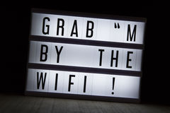 Grab m by the wifi Stock Photography