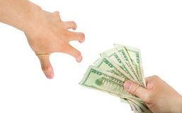 Grab Money. A hand trying to grab money from another hand, on white background with clipping path Stock Photography