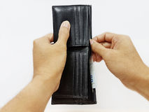 Grab the money to pay. Hand open the wallet and grab the money Stock Photography