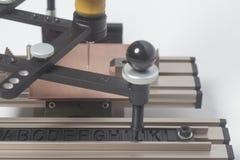 Grabado del pantógrafo del dispositivo con el grabador del CNC con alfabeto de la prensa de copiar imagen de archivo libre de regalías