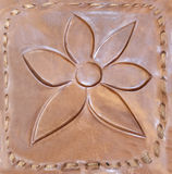 Grabado en relieve en la piel, flor Imagen de archivo libre de regalías