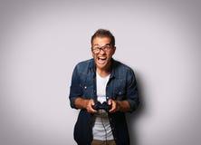 Grabb med en styrspak Fotografering för Bildbyråer