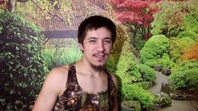 Grabb med ett skägg i djungel lager videofilmer