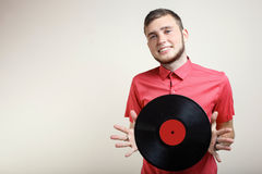 Grabb med ett vinylrekord fotografering för bildbyråer