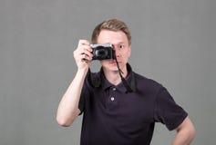 Grabb med kameran royaltyfria bilder
