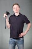 Grabb med kameran arkivfoto