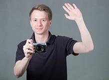 Grabb med kameran royaltyfri bild