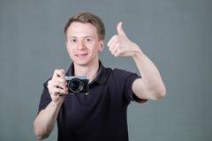 Grabb med kameran royaltyfria foton