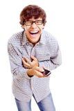 Grabb med telefonen som tjuter med laughter royaltyfria foton