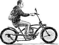 Grabb som rider en cykel Arkivbild