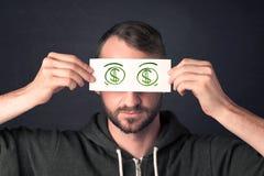 Grabb som rymmer ett papper med det hand drog dollartecknet Royaltyfri Foto