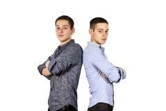 grabbar som poserar två Arkivbilder