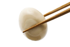 Grabbed egg. With chopsticks Hotchpotch stock images