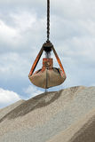 Grabber crane with aggragate. Grabber crane with a load of aggregate Royalty Free Stock Image