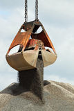 Grabber crane with aggragate stock photography