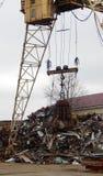Gantry Crane Grabber Loading Scrap Metal At Junkyard royalty free stock image