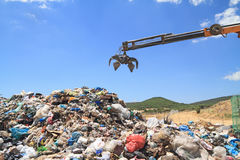 Grabber crane over garbage Stock Photo