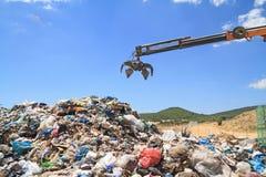 Grabber crane over garbage Stock Photo