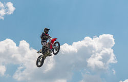Grabbing Air Moto Jump. The free lunchtime entertainment to get people over to the concessions and vendors until the racing was ready to start at Barber Royalty Free Stock Image