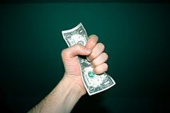 Grabbing a dollar Stock Photography