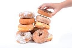Grabbing Donut Stock Images
