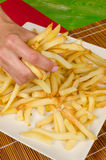 Grabbing french fries Royalty Free Stock Image
