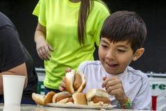 Grabbing a hot dog. Royalty Free Stock Image