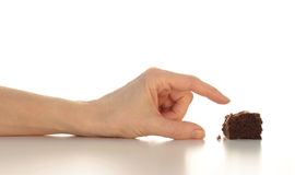 Grabbing the Last Chocolate Brownie Royalty Free Stock Photography