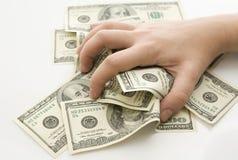 Grabbing money. Isolated on white background Stock Photos