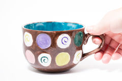 Grabbing Painted Mug Stock Image