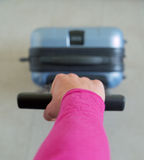 Grabbing the suitcase. To be ready to go Royalty Free Stock Photography