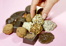 Grabbing a Truffle Chocolate Royalty Free Stock Images