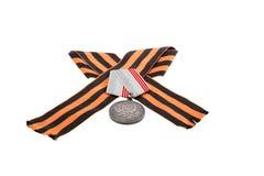 Grabe con una medalla un símbolo del día de la victoria Imagenes de archivo