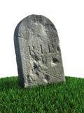 Grabstein auf dem Gras Stockfoto
