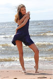 Grace. The young girl on a beach Royalty Free Stock Photo