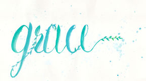 Grace calligraphy design by water color hand lettering in blue green color on white color of paper. Royalty Free Stock Photo