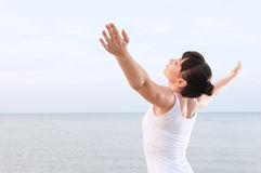 Grace and carefree. Healthy young woman breathing and enjoy the summer breeze outdoor at sea Stock Photos