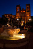 Grace Cathedral Fountain Dusk. Grace Cathedral in San Francisco and an ornate water fountain are lighted at night Stock Photos