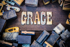 Grace Concept Rusty Type. The word GRACE written in rusted metal letters surrounded by vintage wooden and metal letterpress type stock photos