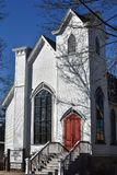 Grace Episcopal Church, Decorah, Iowa. Grace Episcopal church in Decorah, Iowa is a beautiful white church building with wooden doors Stock Photos